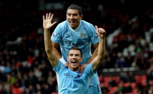 Edin Dzeko celebrates City's 6-1 win over United in 2011