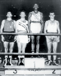 Mohammed Ali on top of the podium after winning boxing gold